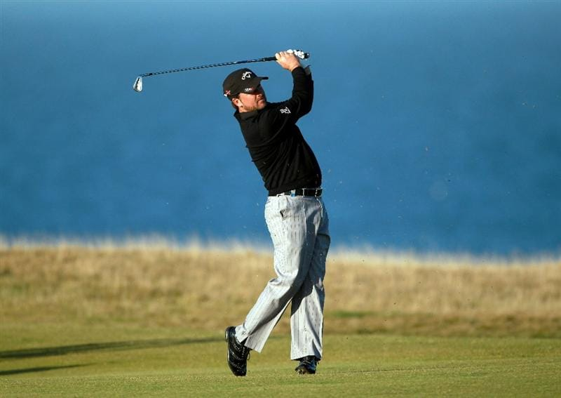 KINGSBARNS, SCOTLAND - OCTOBER 07:  Graeme McDowell of Northern Ireland plays his second shot to the 18th green during the first round of The Alfred Dunhill Links Championship at Kingsbarns Golf Links on October 7, 2010 in Kingsbarns, Scotland.  (Photo by Andrew Redington/Getty Images)