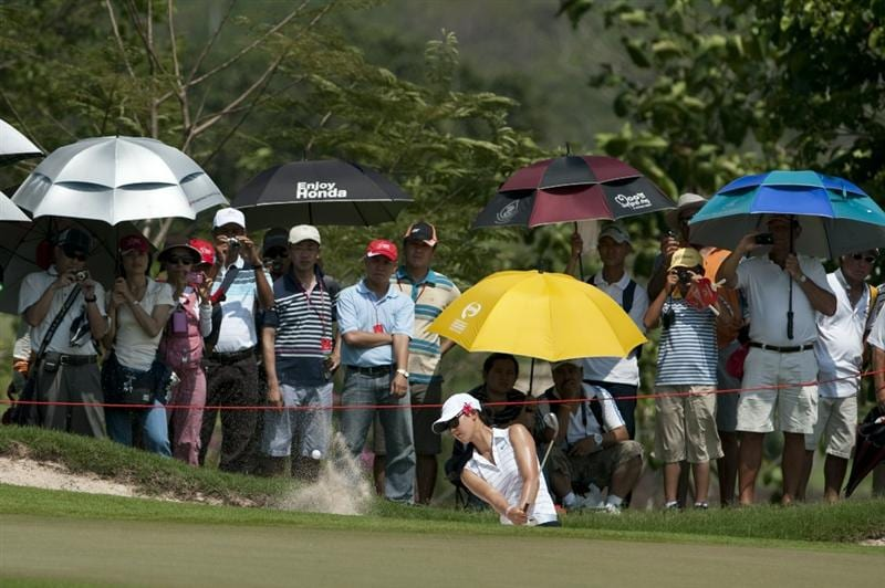 CHON BURI, THAILAND - FEBRUARY 19:  Michelle Wie of USA plays a bunker shot on the 7th hole during day three of the LPGA Thailand at Siam Country Club on February 19, 2011 in Chon Buri, Thailand.  (Photo by Victor Fraile/Getty Images)