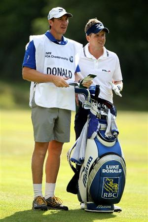 VIRGINIA WATER, ENGLAND - MAY 29:  Luke Donald of England stands with his caddie John McLaren during the final round of the BMW PGA Championship  at the Wentworth Club on May 29, 2011 in Virginia Water, England.  (Photo by Warren Little/Getty Images)