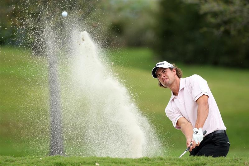 DORAL, FL - MARCH 13: Adam Scott of Australia plays his third shot at the 16th hole during the second round of the World Golf Championships-CA Championship at the Doral Golf Resort & Spa on March 13, 2009 in Miami, Florida  (Photo by David Cannon/Getty Images)