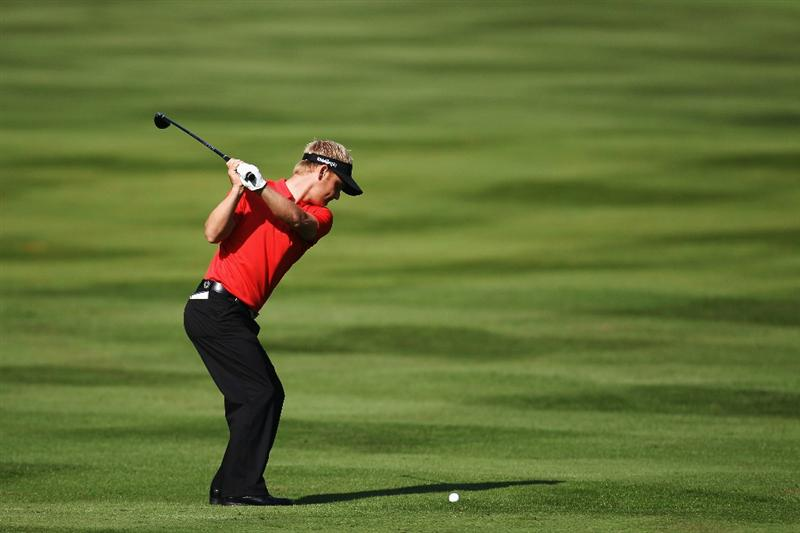 VIRGINIA WATER, ENGLAND - MAY 21:  Soren Kjeldsen of Denmark plays an iron shot during the second round of the BMW PGA Championship on the West Course at Wentworth on May 21, 2010 in Virginia Water, England.  (Photo by Ross Kinnaird/Getty Images)