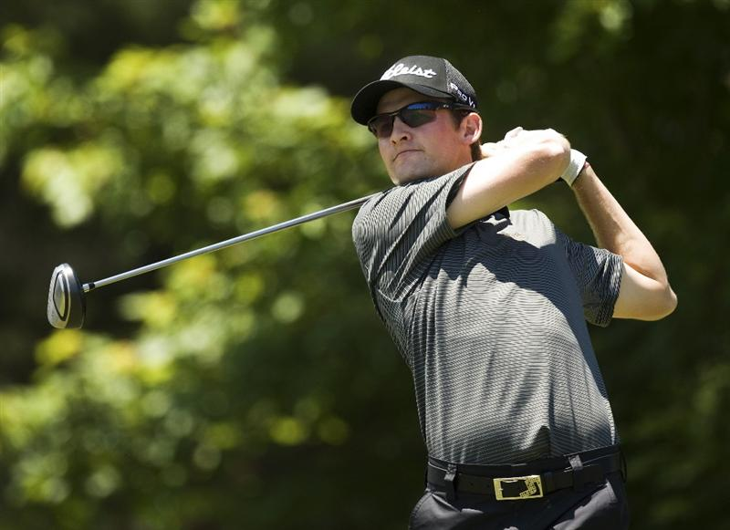 RALEIGH, NC - MAY 30: Michael Sim of Australia  watches his drive on the second hole during the third round of the Rex Hospital Open Nationwide Tour golf tournament at the TPC Wakefield Plantation on May 30, 2009 in Raleigh, North Carolina. (Photo by Chris Keane/Getty Images)