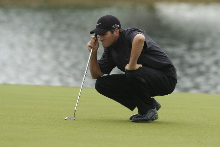 Franklin Langham lines up a putt   during second-round competition March 4, 2005  at the  2005 Ford Championship at Doral in Miami.   Langham shot a 67 to tie for the early lead at nine under par.