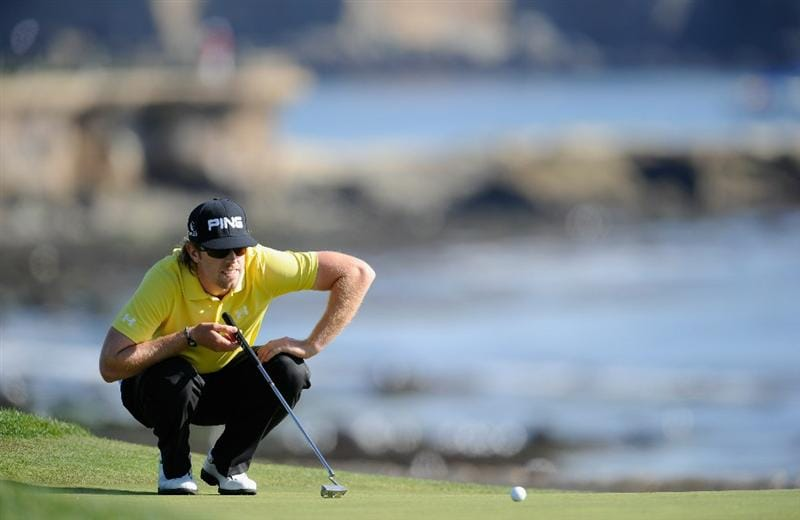 PEBBLE BEACH, CA - FEBRUARY 13:  Hunter Mahan lines up his putt on the 18th hole during the final round of the AT&T Pebble Beach National Pro-Am at Pebble Beach Golf Links on February 13, 2011  in Pebble Beach, California.  (Photo by Stuart Franklin/Getty Images)
