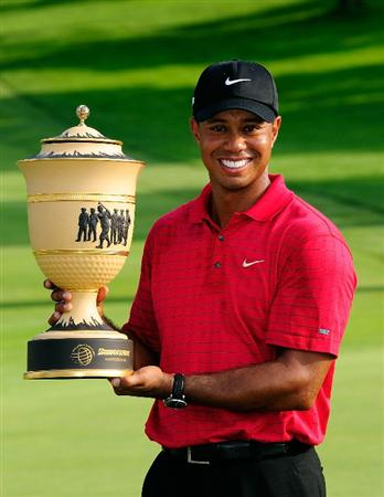 AKRON, OH - AUGUST 09:  Tiger Woods  holds the trophy after winning the WGC-Bridgestone Invitational on the South Course at Firestone Country Club on August 9, 2009 in Akron, Ohio.  (Photo by Sam Greenwood/Getty Images)