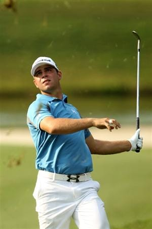 PONTE VEDRA BEACH, FL - MAY 13:  Gary Woodland hits out of the rough on the 12th hole during the second round of THE PLAYERS Championship held at THE PLAYERS Stadium course at TPC Sawgrass on May 13, 2011 in Ponte Vedra Beach, Florida.  (Photo by Mike Ehrmann/Getty Images)