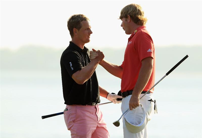 HILTON HEAD ISLAND, SC - APRIL 24:  Luke Donald of England shakes hands with Brandt Snedeker after loosing in a playoff during the final round of The Heritage at Harbour Town Golf Links on April 24, 2011 in Hilton Head Island, South Carolina.  (Photo by Streeter Lecka/Getty Images)