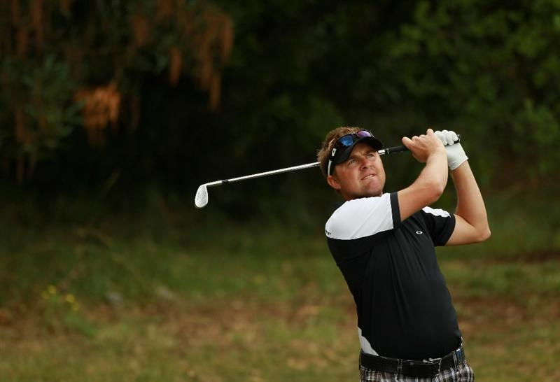 ESTORIL, PORTUGAL - JUNE 12:  Andrew Tampion of Australia plays his second shot into the second green during the third round of the Estoril Open de Portugal at Penha Longa Hotel Spa and Golf Club on June 12, 2010 in Estoril, Portugal.  (Photo by Warren Little/Getty Images)