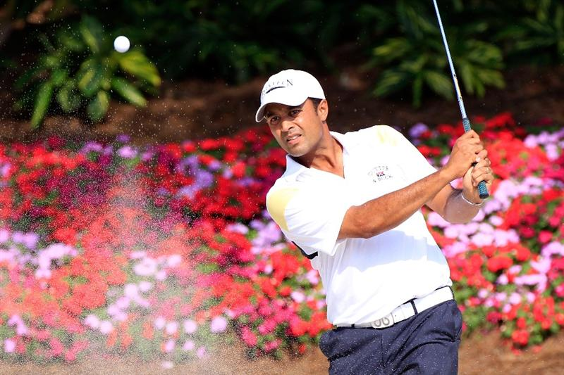 PONTE VEDRA BEACH, FL - MAY 12:  Arjun Atwal of India hits from a bunker on the 14th hole during the first round of THE PLAYERS Championship held at THE PLAYERS Stadium course at TPC Sawgrass on May 12, 2011 in Ponte Vedra Beach, Florida.  (Photo by Sam Greenwood/Getty Images)