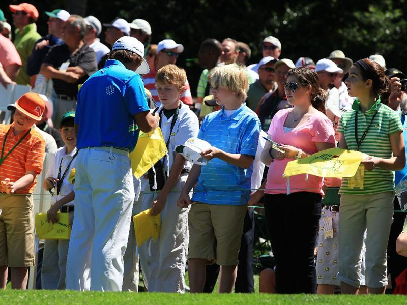 AUGUSTA, GA - APRIL 06:  Rickie Fowler signs autographs for fans during the Par 3 Contest prior to the 2011 Masters Tournament at Augusta National Golf Club on April 6, 2011 in Augusta, Georgia.  (Photo by David Cannon/Getty Images)