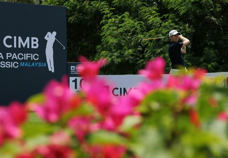 KUALA LUMPUR, MALAYSIA - OCTOBER 28: Andrew Dodt of Australia tees off on the 10th hole during day one of the CIMB Asia Pacific Classic at The MINES Resort & Golf Club on October 28, 2010 in Kuala Lumpur, Malaysia. (Photo by Stanley Chou/Getty Images)