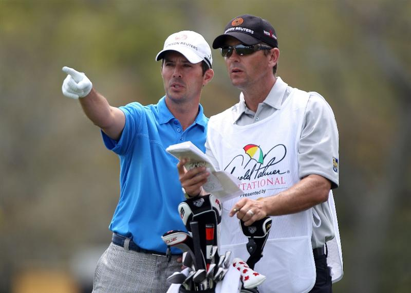 ORLANDO, FL - MARCH 25:  Mike Weir of Canada chats with his caddie Brennan Little on the 18th hole during the first round of the Arnold Palmer Invitational presented by MasterCard at the Bayhill Club and Lodge on March 25, 2010 in Orlando, Florida.  (Photo by Scott Halleran/Getty Images)
