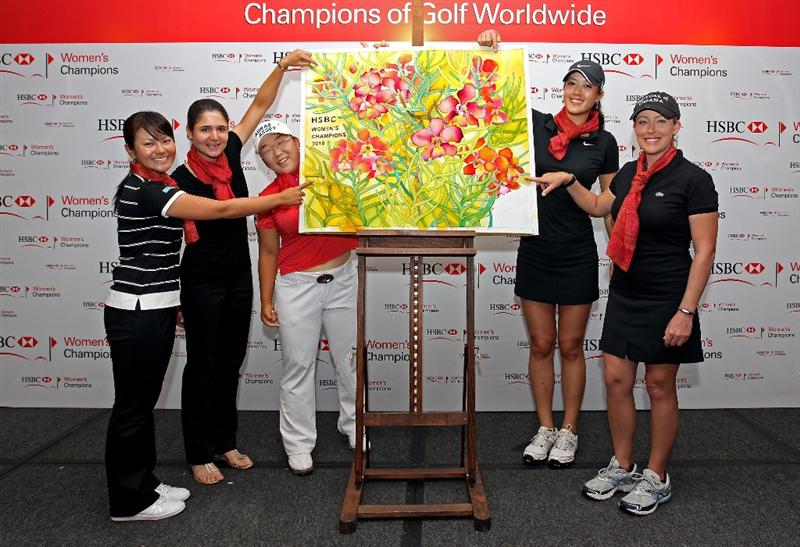 SINGAPORE - FEBRUARY 23:  (L-R) Ai Miyazato of Japan, Lorena Ochoa of Mexico, Jiyai Shin of South Korea, Michelle Wie of the USA and Christie Kerr of the USA pall point to the section of the batik artwork they contributed to during a photocall at Raffles Hotel prior to the HSBC Women's Champions at the Tanah Merah Country Club  on February 23, 2010 in Singapore.  (Photo by Andrew Redington/Getty Images)