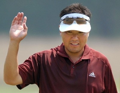 Charlie Wi of South Korea acknowledges the gallery after putting on the 18th green during the second round of the Wyndham Championship at Forest Oaks Country Club on August 17, 2007 in Greensboro, North Carolina. PGA TOUR - 2007 Wyndham Championship - Second RoundPhoto by Jonathan Ernst/WireImage.com