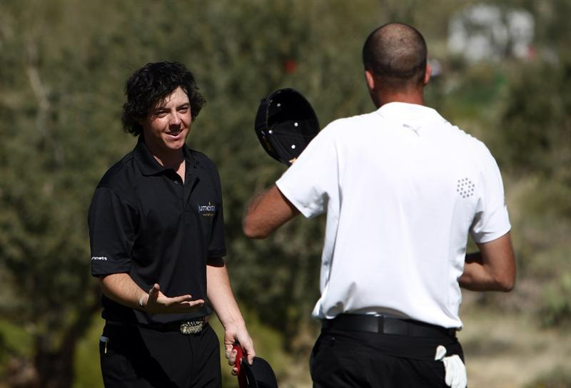 MARANA, AZ - FEBRUARY 28:  Rory McIlroy of Northern Ireland shakes the hand of Geoff Ogilvy of Australia after Ogilvy's 2 & 1 victory during the quarter-final round of the Accenture Match Play Championships at the Ritz-Carlton Golf Club at Dove Mountain on February 28, 2009 in Marana, Arizona. Ogilvy won the match 2 & 1. (Photo by Donald Miralle/Getty Images)