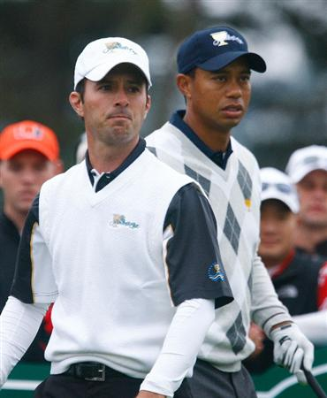 SAN FRANCISCO - OCTOBER 10:  Mike Weir of the International Team watches his tee shot on the fifth hole as Tiger Woods of the USA Team looks on during the Day Three Morning Foursome Matches of The Presidents Cup at Harding Park Golf Course on October 10, 2009 in San Francisco, California.  (Photo by Scott Halleran/Getty Images)