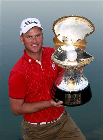 DOHA, QATAR - JANUARY 31:  Robert Karlsson of Sweden poses with the trophy after winning the Commercialbank Qatar Masters at Doha Golf Club on January 31, 2010 in Doha,Qatar.  (Photo by Andrew Redington/Getty Images)