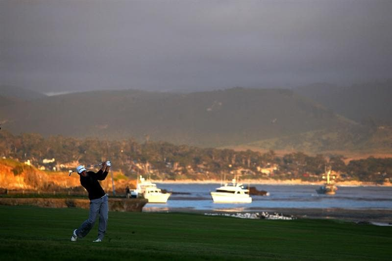 PEBBLE BEACH, CA - JUNE 19:  Dustin Johnson watches his second shot on the 18th hole during the third round of the 110th U.S. Open at Pebble Beach Golf Links on June 19, 2010 in Pebble Beach, California.  (Photo by Donald Miralle/Getty Images)