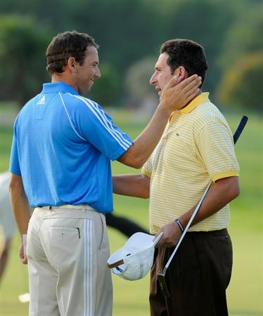 CASTELLON DE LA PLANA, SPAIN - OCTOBER 22:  Sergio Garcia and Jose Maria Olazabal of Spain on the 18th hole during the second round of the Castello Masters Costa Azahar at the Club de Campo del Mediterraneo on October 22, 2010 in Castellon de la Plana, Spain.  (Photo by Stuart Franklin/Getty Images)