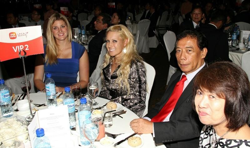 KUALA LUMPUR, MALAYSIA - OCTOBER 22 : Natalie Gulbis (2L) with VIP Guests during the Sime Darby LPGA Charity Gala Dinner on October 22, 2010 at the Sime Darby Convention Centre in Kuala Lumpur, Malaysia. (Photo by Stanley Chou/Getty Images)