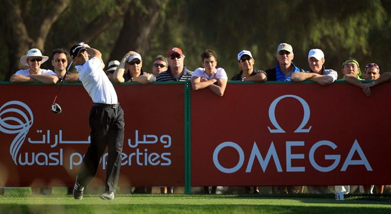 DUBAI, UNITED ARAB EMIRATES - FEBRUARY 12:  Sergio Garcia of Spain plays his tee shot on the par 4, 16th hole during the third round of the 2011 Omega Dubai Desert Classic on the Majilis Course at the Emirates Golf Club on February 12, 2011 in Dubai, United Arab Emirates.  (Photo by David Cannon/Getty Images)