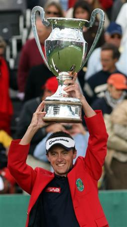 CRANS, SWITZERLAND - SEPTEMBER 07:  Jean-Francois Lucquin of France with the winners trophy after the final round of the Omega European Masters at the Golf Club Crans-sur-Sierre on September 7, 2008 in Crans, Switzerland.  (Photo by Ross Kinnaird/Getty Images)