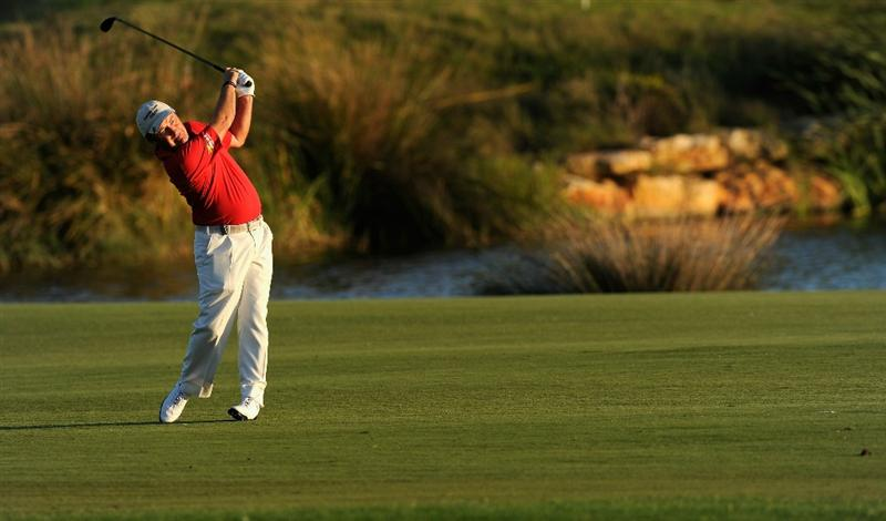 FARO, PORTUGAL - OCTOBER 14:  Damien McGrane of Ireland plays his approach shot on the 18th hole during the first round of the Portugal Masters at the Oceanico Victoria Golf Course on October 14, 2010 in Faro, Portugal.  (Photo by Stuart Franklin/Getty Images)