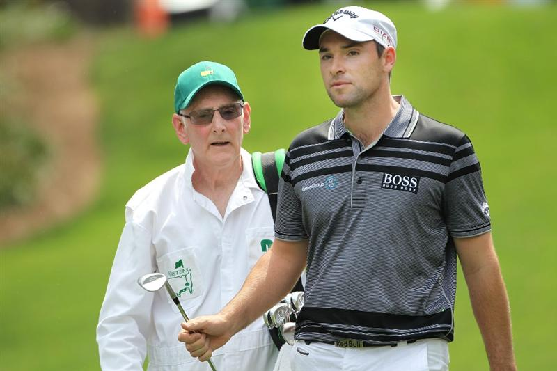 AUGUSTA, GA - APRIL 07:  Oliver Wilson of England walks with his caddie/father during the Par 3 Contest prior to the 2010 Masters Tournament at Augusta National Golf Club on April 7, 2010 in Augusta, Georgia.  (Photo by Jamie Squire/Getty Images)