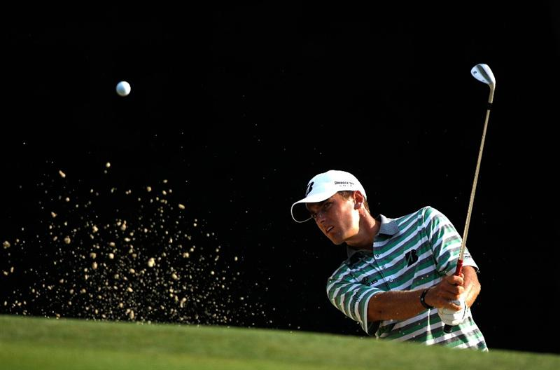 GREENSBORO, NC - AUGUST 20:  Charles Howell III hits a shot from the sand on the 5th hole during the first round of the Wyndham Championship at Sedgefield Country Club on August 20, 2009 in Greensboro, North Carolina  (Photo by Streeter Lecka/Getty Images)