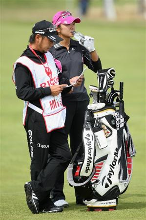 LYTHAM ST ANNES, ENGLAND - AUGUST 01:  Yuko Mitsuka of Japan waits with her caddie on the 2nd hole during the third round of the 2009 Ricoh Women's British Open Championship held at Royal Lytham St Annes Golf Club, on August 1, 2009 in Lytham St Annes, England.  (Photo by David Cannon/Getty Images)