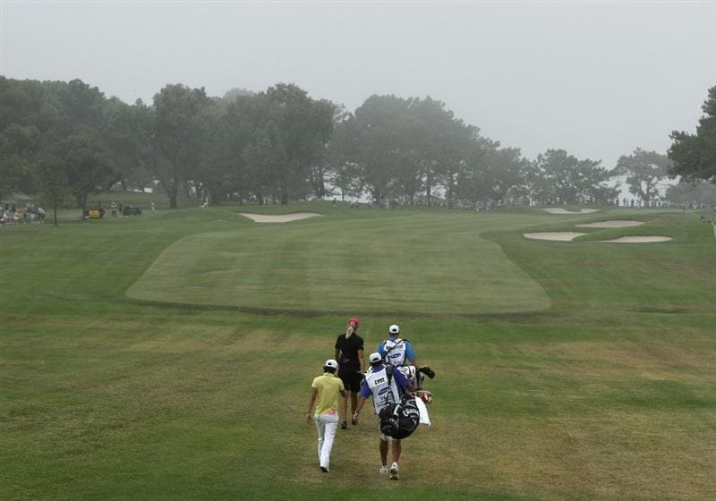 LA JOLLA, CA - SEPTEMBER 18:  Anna Nordqvist of Sweden and Na Yeon Choi of South Korea walk on a foggy 1st hole during the second round of the LPGA Samsung World Championship on September 18, 2009 at Torrey Pines Golf Course in La Jolla, California.  (Photo By Donald Miralle/Getty Images)