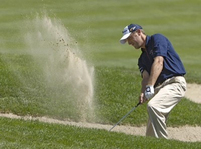 Jeff Gove blasts out of the bunker on the 1st hole during the fourth and final round of The INTERNATIONAL held at Castle Pines Golf Club in Castle Rock, Colorado, on August 13, 2006.Photo by Marc Feldman/WireImage.com