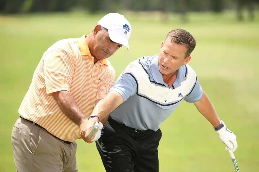 Breed gives Al Del Greco swing tips.