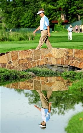 CHASKA, MN - AUGUST 13:  David Toms crosses a bridge on the 16th hole during the first round of the 91st PGA Championship at Hazeltine National Golf Club on August 13, 2009 in Chaska, Minnesota.  (Photo by Stuart Franklin/Getty Images)