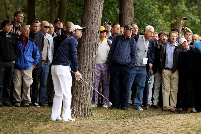 VIRGINIA WATER, ENGLAND - MAY 27:  Paul Casey of England hits from trouble on the 15th hole during the second round of the BMW PGA Championship at the Wentworth Club on May 27, 2011 in Virginia Water, England.  (Photo by Ian Walton/Getty Images)