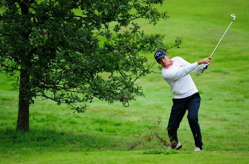 HILVERSUM, NETHERLANDS - SEPTEMBER 10:  Nick Dougherty of England plays his approach shot on the third hole during the second round of  The KLM Open Golf at The Hillversumsche Golf Club on September 10, 2010 in Hilversum, Netherlands.  (Photo by Stuart Franklin/Getty Images)