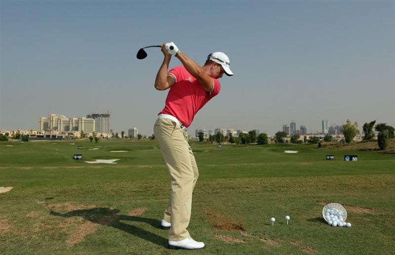 DUBAI, UNITED ARAB EMIRATES - NOVEMBER 24:  Henrik Stenson of Sweden in action on the practice ground prior to the start of the Dubai World Championship on the Earth Course, Jumeirah Golf Estates on November 24, 2010 in Dubai, United Arab Emirates.  (Photo by Andrew Redington/Getty Images)