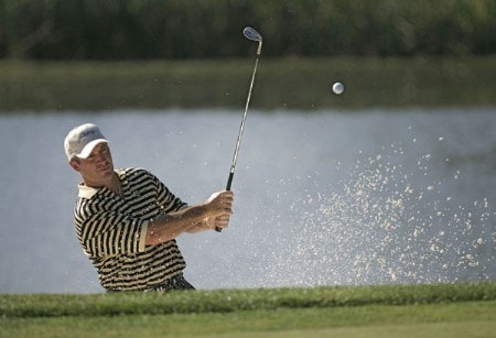 Peter Lonard of the International team chipping out of a bunker during a practice round at The Presidents Cup at Robert Trent Jones Golf Club in Prince William County, Virginia on September 21, 2005.Photo by Sam Greenwood/WireImage.com