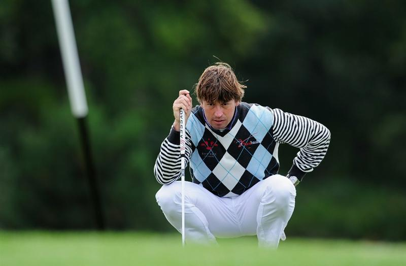 PARIS - SEPTEMBER 25:  Robert - Jan Derksen of The Netherlands lines up his putt on the 10th hole during the third round of the Vivendi cup at Golf de Joyenval on September 25, 2010 in Chambourcy, near Paris, France.  (Photo by Stuart Franklin/Getty Images)