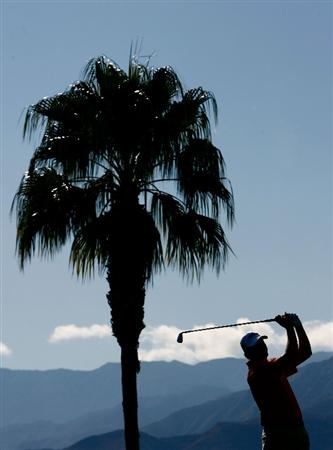 LA QUINTA, CA - JANUARY 25:  A silhouette of D.J. Trahan as he hits his tee shot on the third hole during the final round of the Bob Hope Chrysler Classic at the Palmer Course at PGA West on January 25, 2009 in La Quinta, California.  (Photo by Jeff Gross/Getty Images)