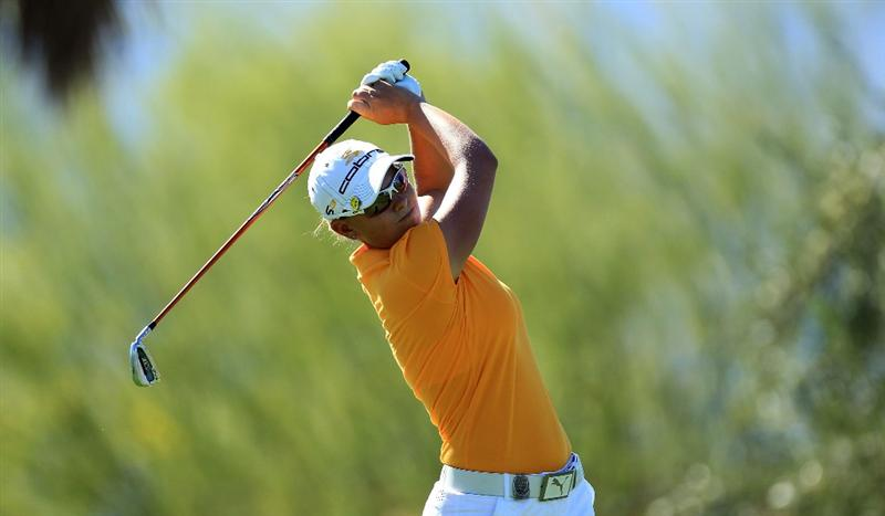 RANCHO MIRAGE, CA - MARCH 31:  Lee-Anne Pace of South Africa plays her tee shot at the par 3, 8th hole during the first round of the 2011 Kraft Nabisco Championship on the Dinah Shore Championship Course at the Mission Hills Country Club on March 31, 2011 in Rancho Mirage, California.  (Photo by David Cannon/Getty Images)