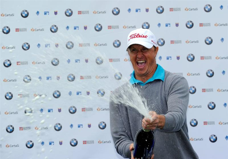 TURIN, ITALY - MAY 09:  Fredrik Andersson Hed of Sweden celebrates with champagne after winning the BMW Italian Open at Royal Park I Roveri on May 9, 2010 in Turin, Italy.  (Photo by Stuart Franklin/Getty Images)