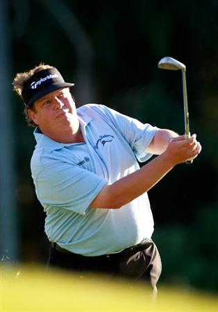 LAKE BUENA VISTA, FL - NOVEMBER 11:  Tim Herron plays a shot on the 17th hole during the first round of the Children's Miracle Network Classic at the Disney Palm and Magnolia courses on November 11, 2010 in Lake Buena Vista, Florida.  (Photo by Sam Greenwood/Getty Images)