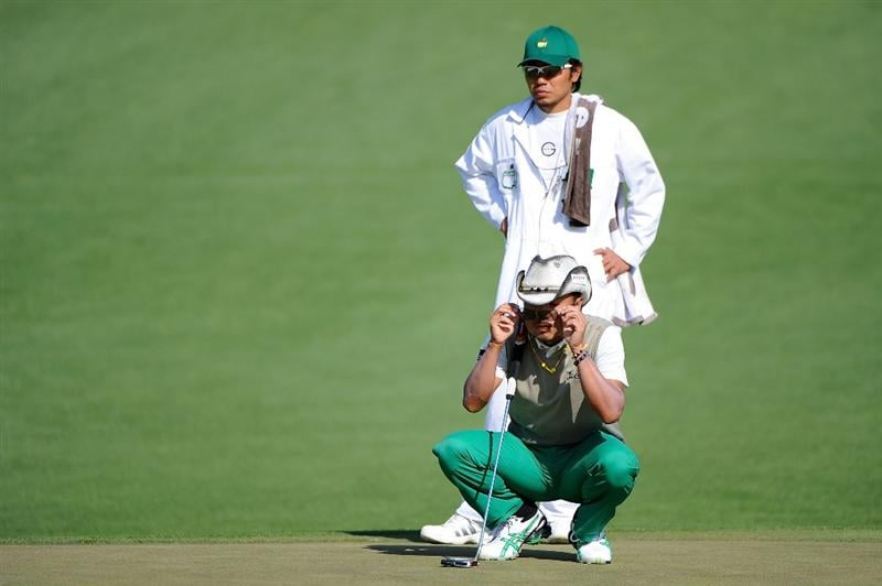 AUGUSTA, GA - APRIL 09:  Shingo Katayama of Japan lines up a putt with his caddie Masaki Tani on the second hole during the first round of the 2009 Masters Tournament at Augusta National Golf Club on April 9, 2009 in Augusta, Georgia.  (Photo by Harry How/Getty Images)