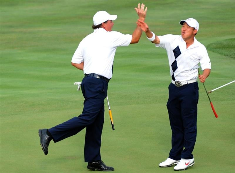 LOUISVILLE, KY - SEPTEMBER 19:  Phil Mickelson and Anthony Kim of the USA team celebrate on the 18th green during the afternoon four-ball matches on day one of the 2008 Ryder Cup at Valhalla Golf Club on September 19, 2008 in Louisville, Kentucky.  (Photo by Harry How/Getty Images)
