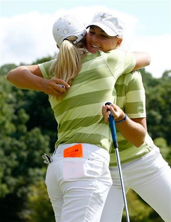 SUGAR GROVE, IL - AUGUST 22:  The European Team of Anna Nordqvist and Suzann Pettersen hug on the 18th green after defeating the U.S. Team of Kerr and Castrale 2up during the saturday morning fourball matches at the 2009 Solheim Cup at Rich Harvest Farms on August 22, 2009 in Sugar Grove, Illinois.  (Photo by Scott Halleran/Getty Images)