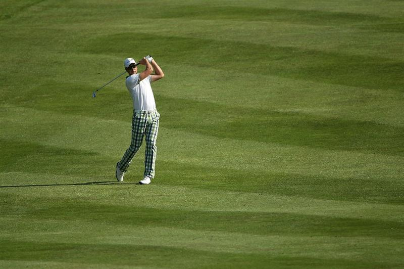 VIRGINIA WATER, ENGLAND - MAY 21:  Henrik Stenson of Sweden hits his second shot on the 4th hole during the second round of the BMW PGA Championship on the West Course at Wentworth on May 21, 2010 in Virginia Water, England.  (Photo by Andrew Redington/Getty Images)