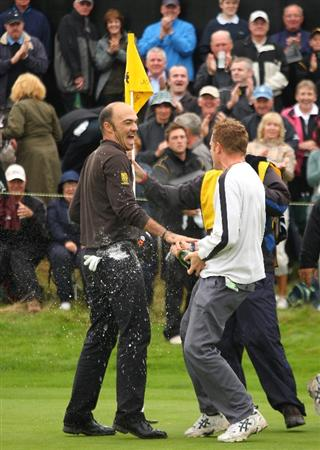 PERTH, UNITED KINGDOM - AUGUST 31:  Gregory Havret of France is sprayed with champagne after holing the winning putt on the 18th hole during the final round of The Johnnie Walker Championship at Gleneagles on August 31, 2008 at the Gleneagles Hotel and Resort in Perthshire, Scotland.  (Photo by Andrew Redington/Getty Images)