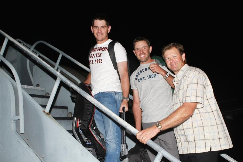 JACKSONVILLE, FL - MAY 15:  European Tour players Louis Oosthuizen of South Africa, Charl Schwartzel of South Africa and Retief Goosen of South Africa board a plane departing from the Jacksonville Airport for Spain and the Volvo World Match Play Championship on May 15, 2011 in Jacksonville, Florida.  (Photo by Scott Halleran/Getty Images for IMG)