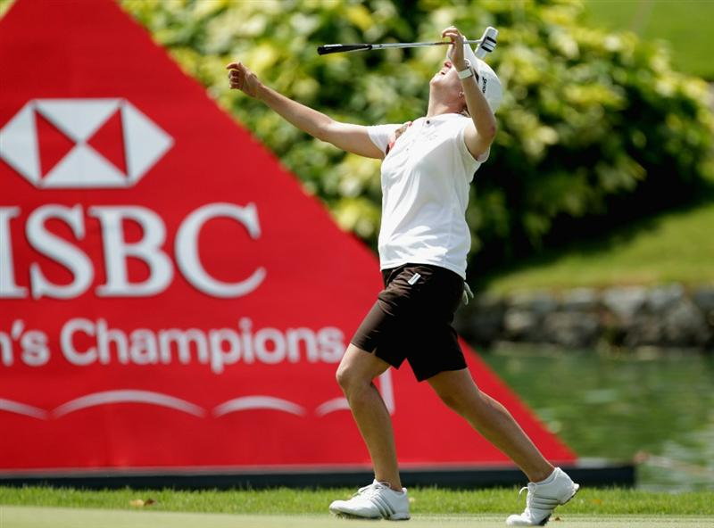 SINGAPORE - FEBRUARY 24:  Karrie Webb of Australia watches her putt on the 7th green during the first round of the HSBC Women's Champions at Tanah Merah Country Club  on February 24, 2011 in Singapore, Singapore.  (Photo by Ross Kinnaird/Getty Images)
